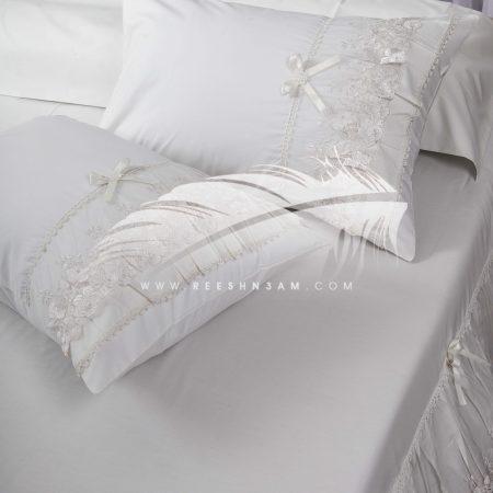 طقم سرير مطرز بالدانتيل